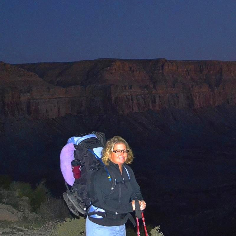 Jenn getting reading to hike to Havasu Falls with a full pack at dawn