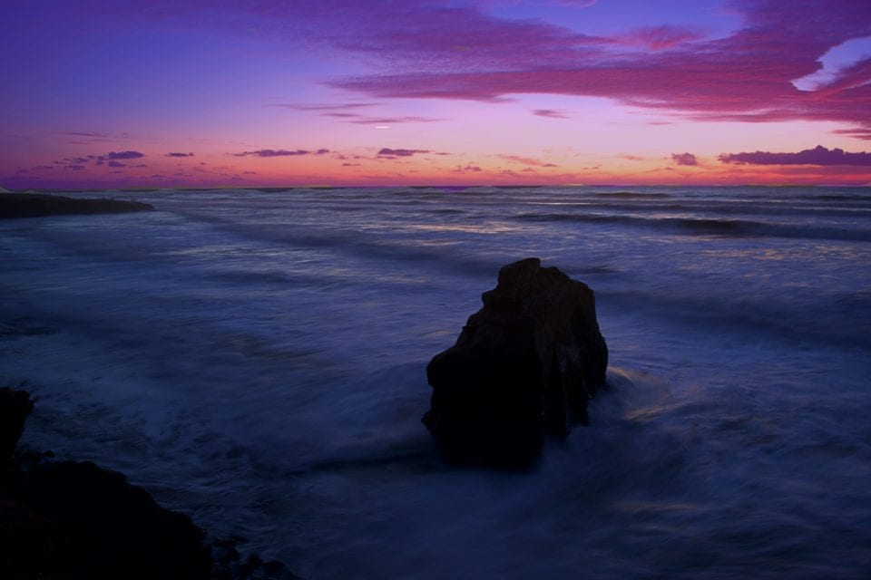 the 30 second exposure turned the rough seas into cotton candy and captured all the purple rays