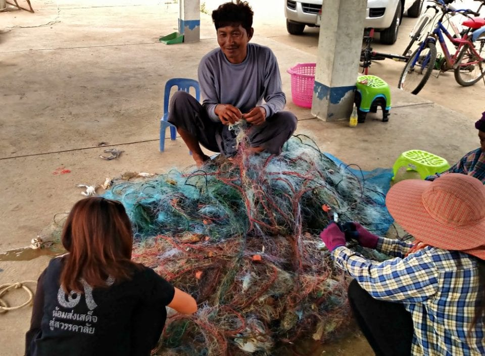 Cleaning the nets at the fishing dock