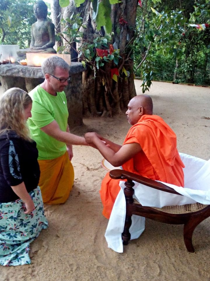 Ed and Jenn being blessed by a Buddhist monk