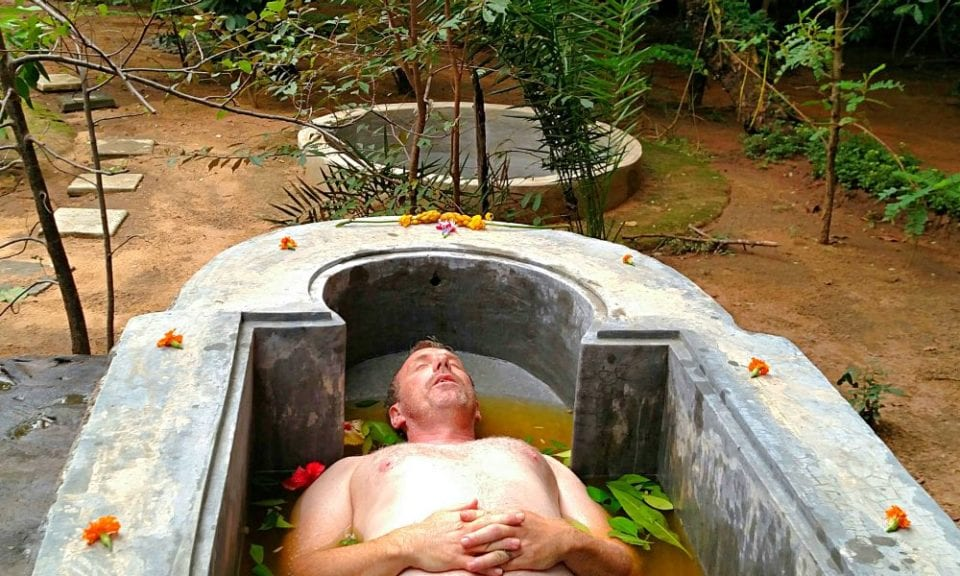 Ed soaking in an herbal Ayurvedic bath