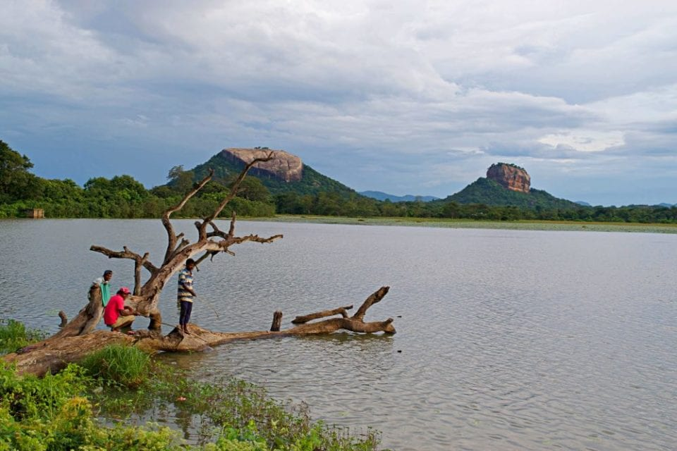 Pidurangala Rock and Sigiriya Rock reflecting across a lake in Sri Lanka