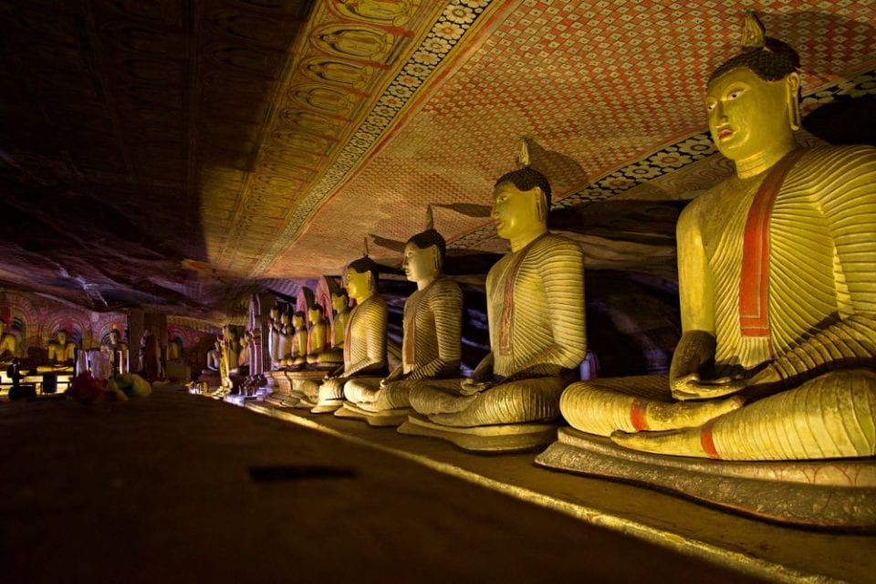 A line of Buddhas inside of the Dambulla Cave Temples