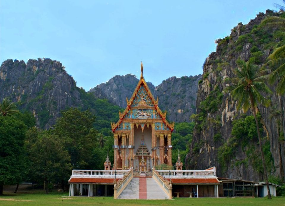 Temple at Khao Sam Roi Yot National Park with kiss of cliffs