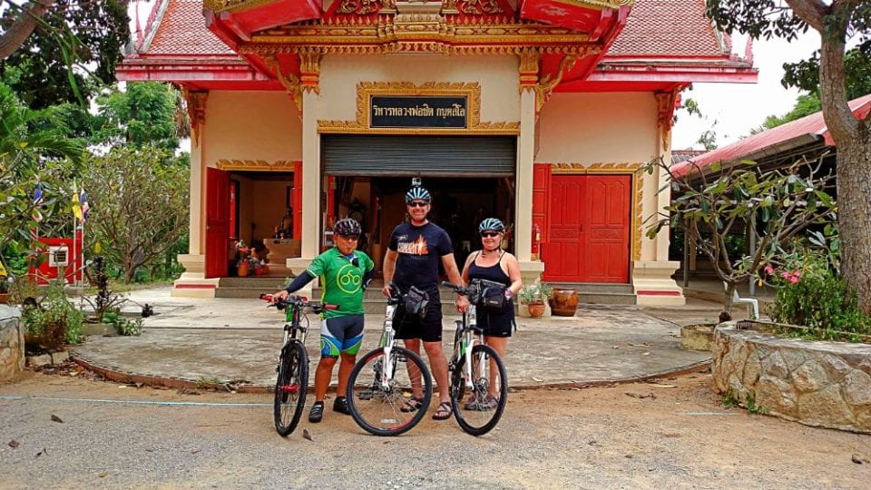 Jenn, Ed, and Tick at Khoa Tao Temple getting ready to cycle at Khao Tao Temple