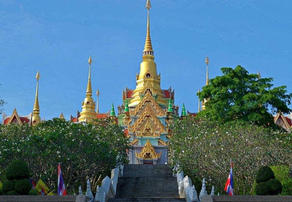Climbing the stairs to Phra Mahathat Chedi Baan Grood