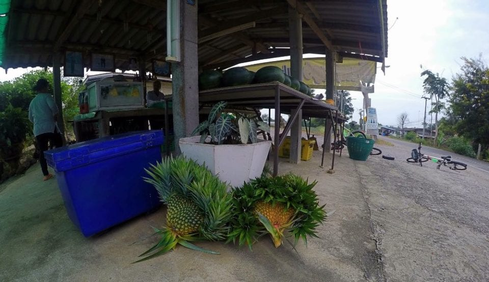Fruit stand in Thailand with heart shaped pineapples for temple donations