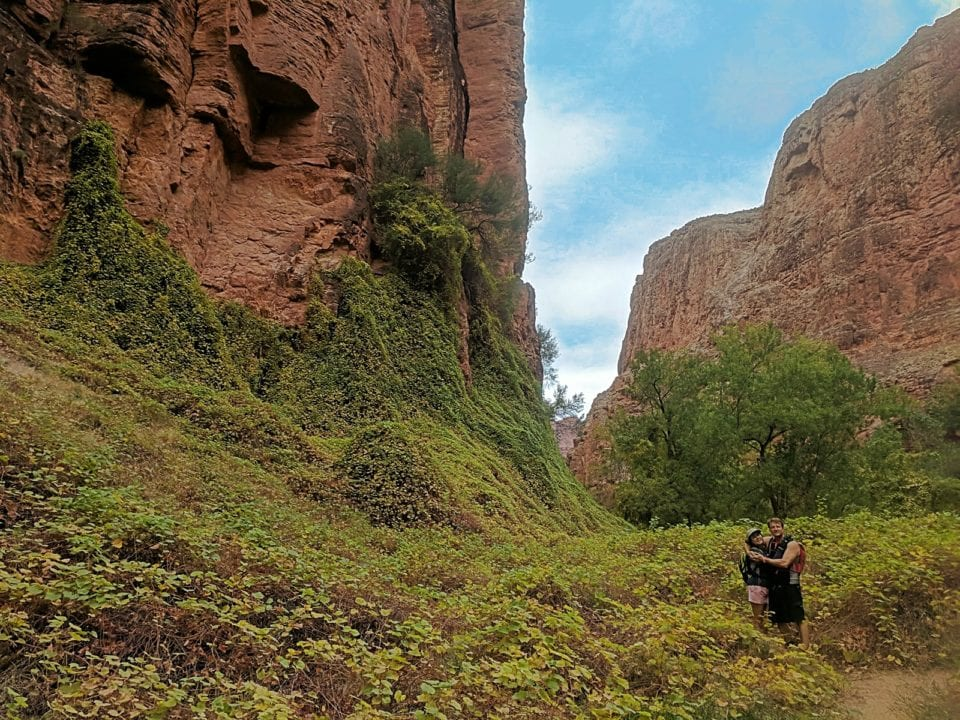 Spencer and Christina hiking down canyon past Mooney Falls