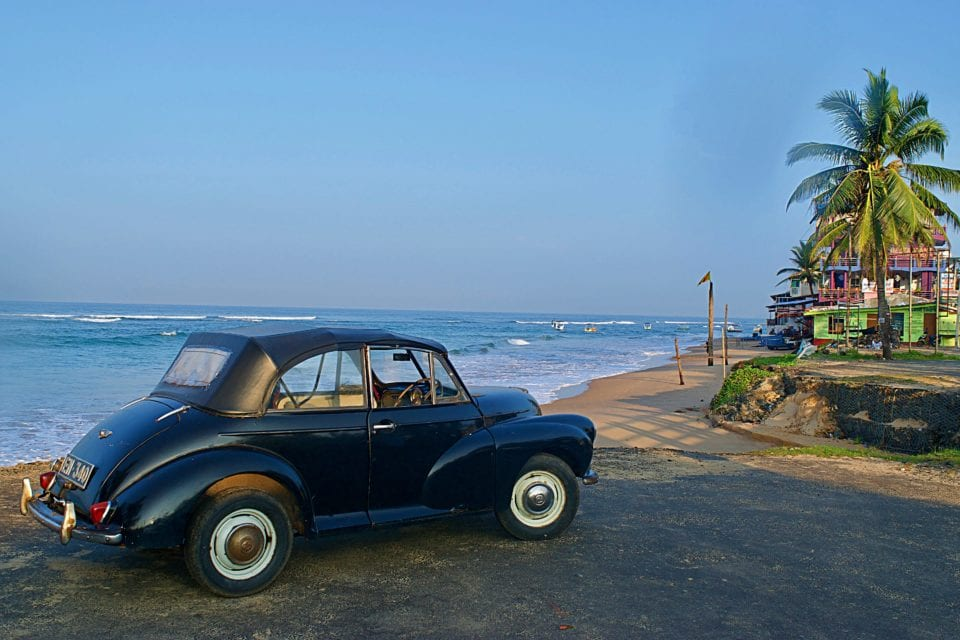 A interesting classic car on the beach at Hikkaduwa Sri Lanka.