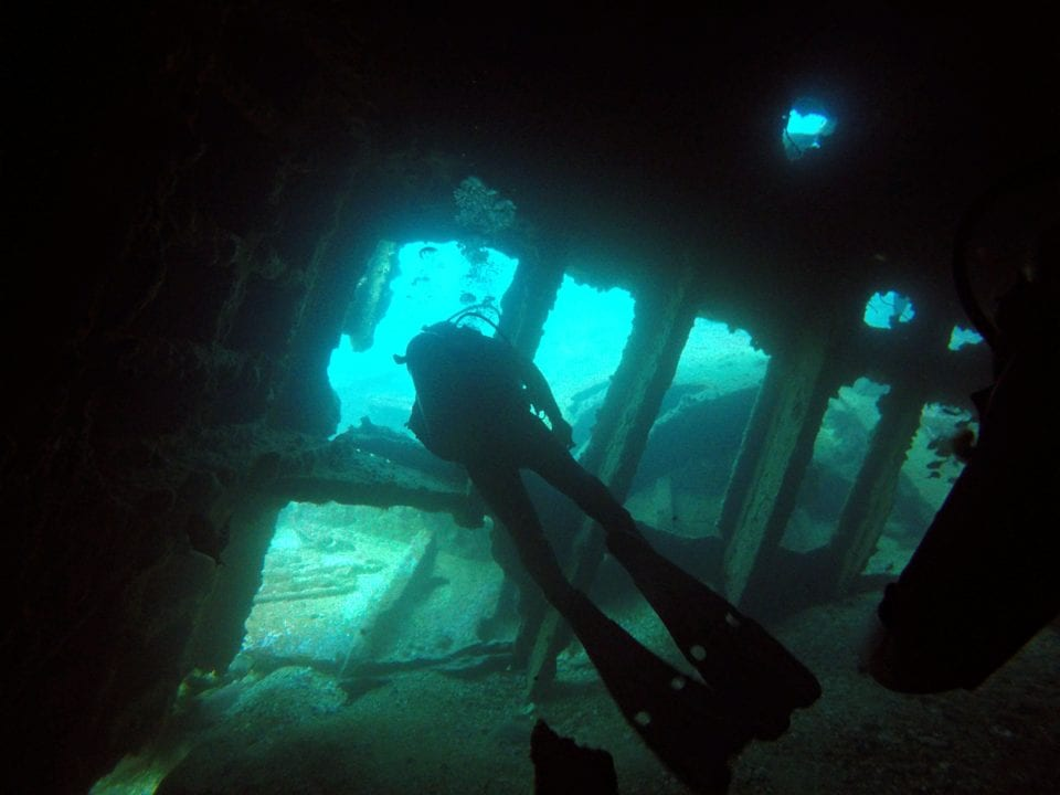 Going through a wreck on a Sri Lanka Dive
