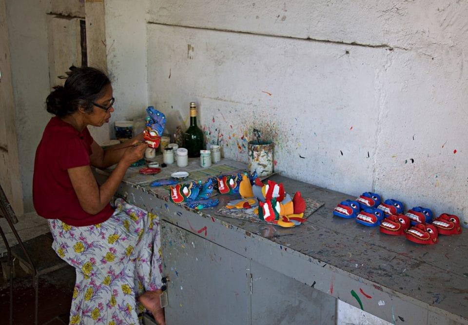 A loca craftsman creating art at the Ambalangoda Mask Workshop and Museum in Sri Lanka.