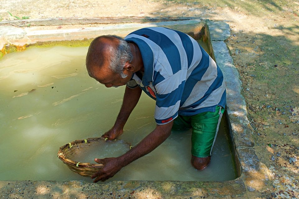 Washing Moonstone at the mine near Hikkaduwa Sri Lanka