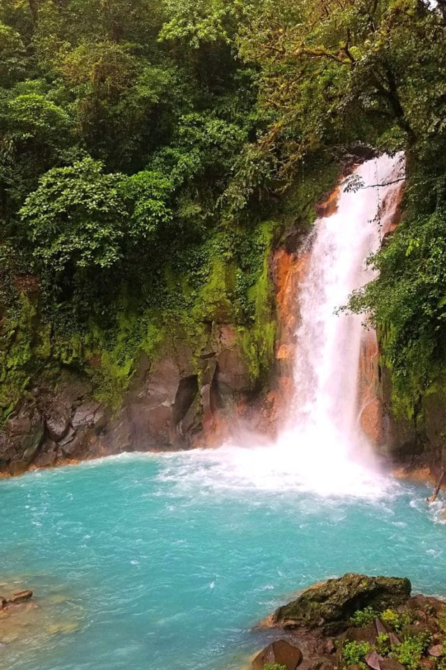 Have you dreamed of visiting Rio Celeste Waterfall in Costa Rica's Tenorio Volcano National Park? Click pin for our complete guide including the 13 things you need to know before you visit this bucket list Costa Rican natural wonder. #CostaRica #Waterfalls #RioCeleste