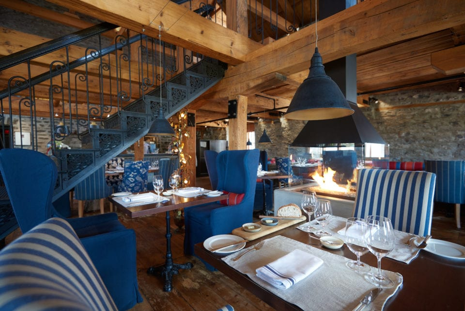 Exposed beams, authentic stone walls and a warm fire in the fireplace makes Chez Muffy on of the coziest restaurants in Quebec