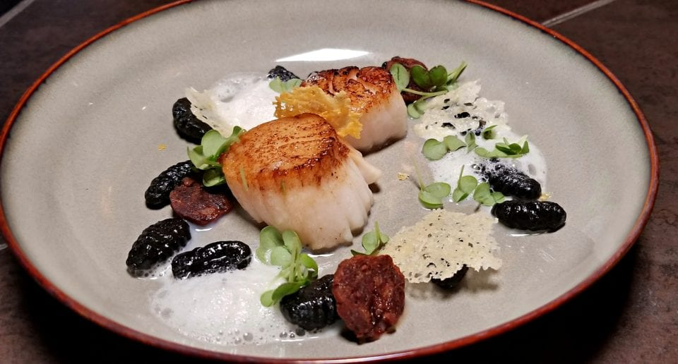 Seared Scallops with squid ink gnocchi. Locally sourced from Chez Muffy