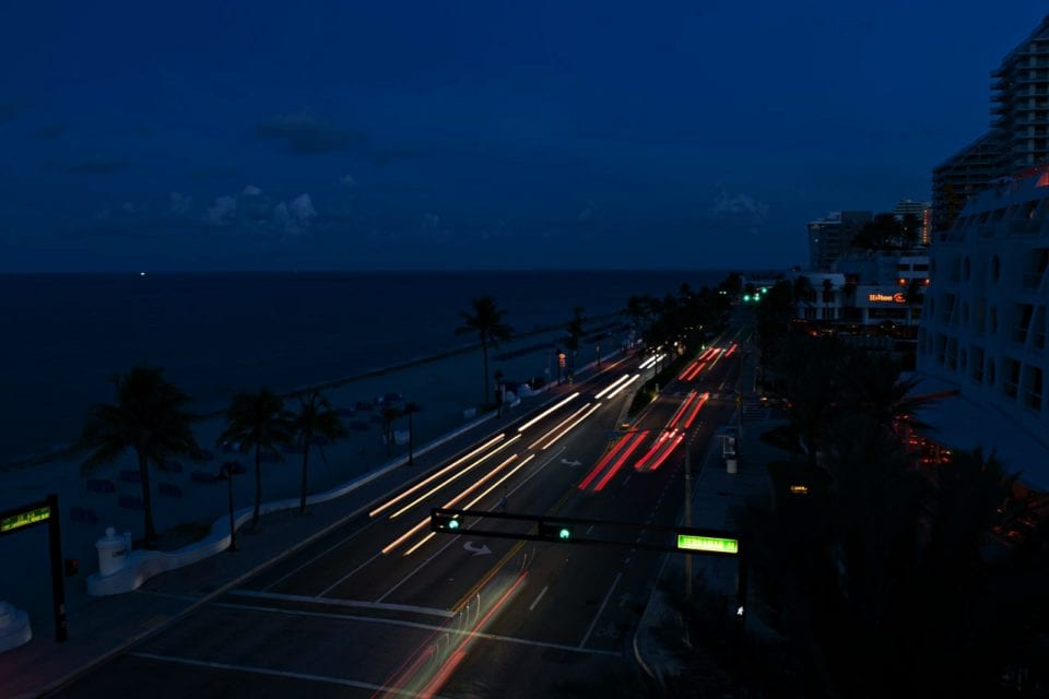 Bright lights on the A1-A highway right next to the beach in Fort Lauderdale