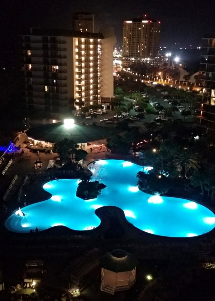 Arial view of Edgewater Beach & Golf Resort lagoon pool at night