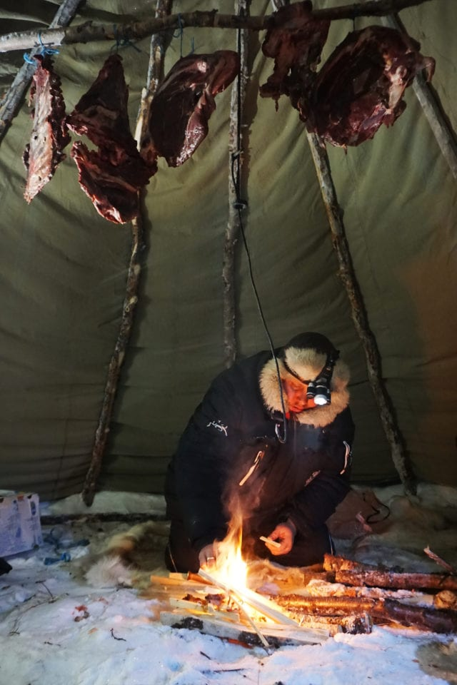 Sami man smoking meat via Kelley Louise: Impact Travel Alliance (link in photo)