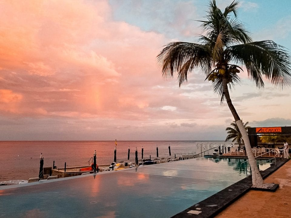 Sunset over pool at Coral Sands Cozumel