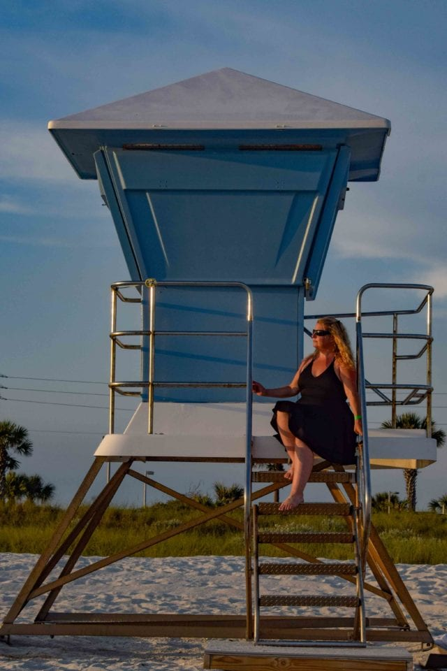 Jenn on lifeguard tower at Panama City Beach (photo by Adam@GettingStamped)