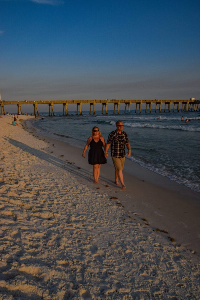 Jenn and Ed walking hand in hand at Panama City Beach