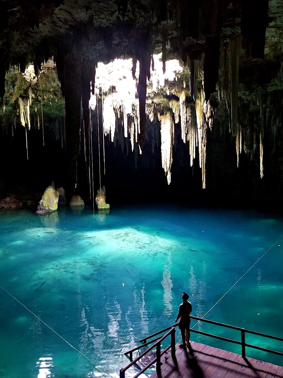 Man-gazing-at-Cenote-Xcanahaltun