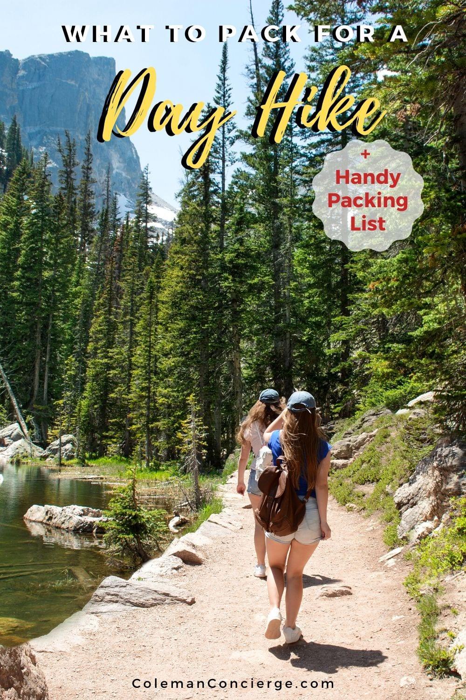2 girls hiking beside lake