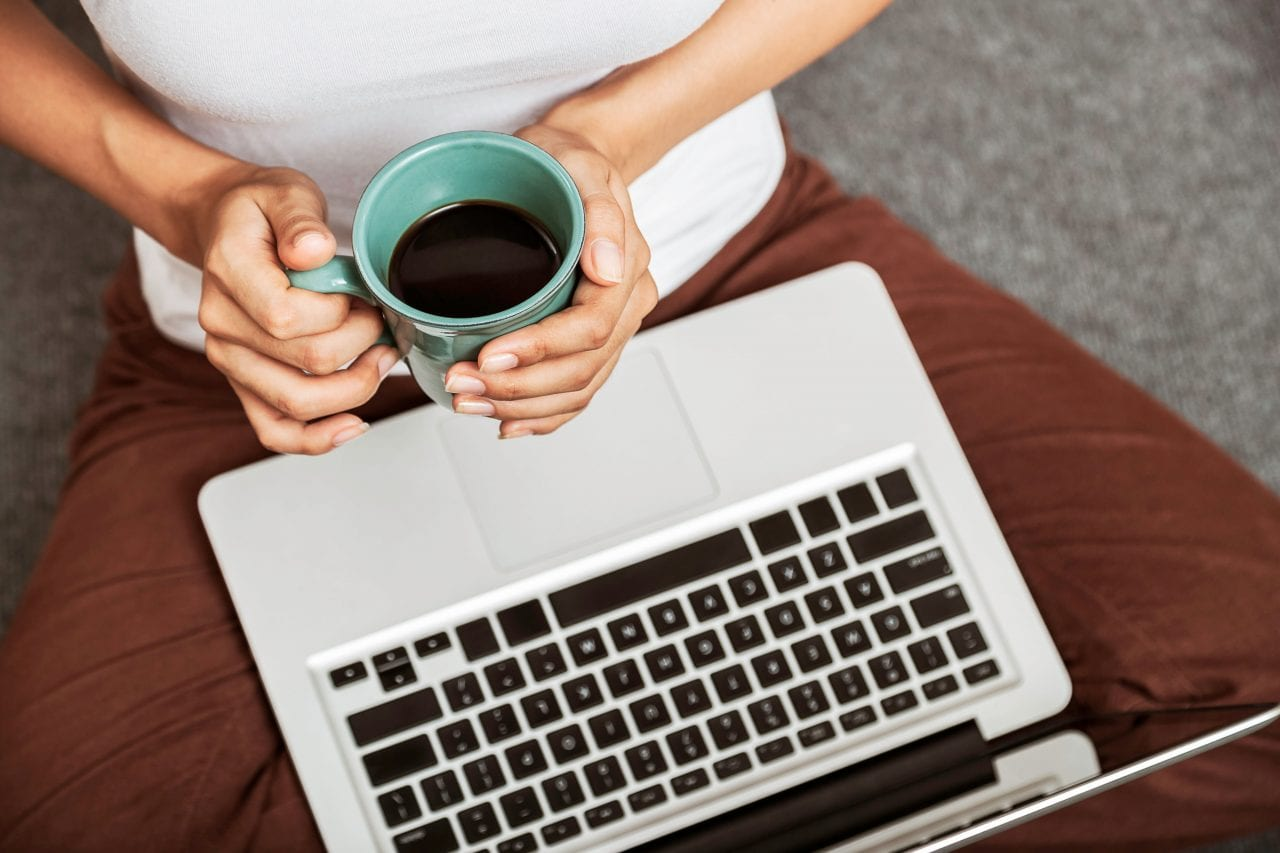 a cup of coffee and a laptop