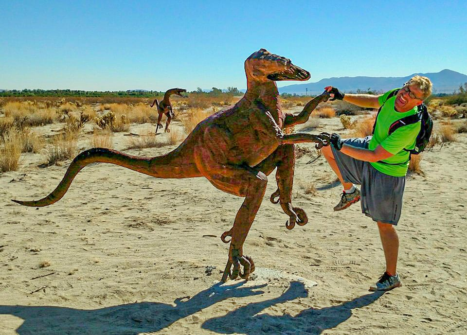 Ed dancing with a velociraptor