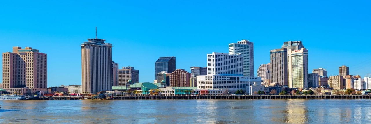 New Orleans Skyline via Canva from the Mississippi River Trail
